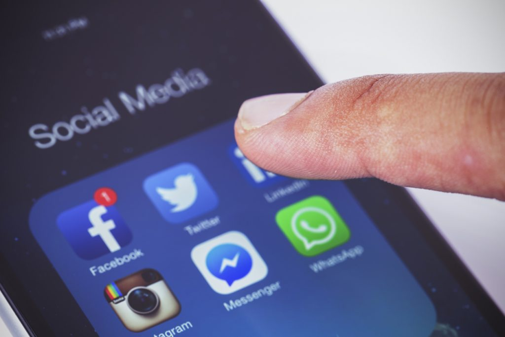 Image of social media and the facebook app on a smart phone