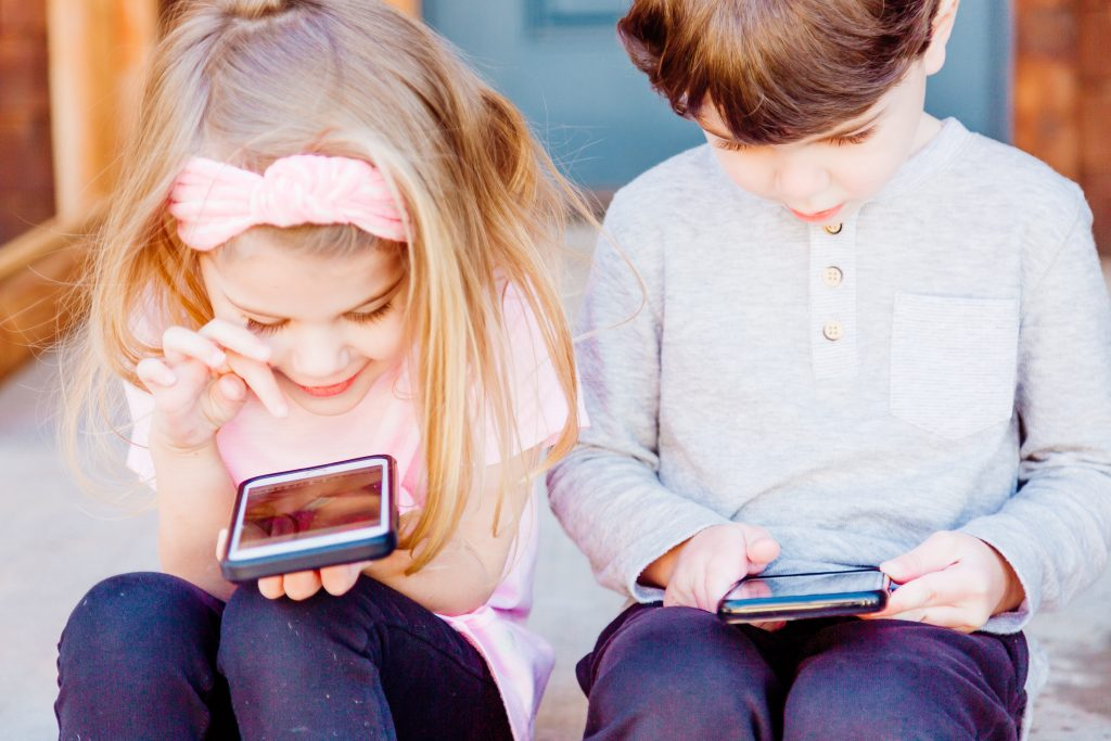 Kids using smartphones and looking at social media